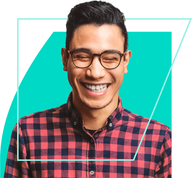 Young man wearing glasses, feeling good and grinning enthusiastically