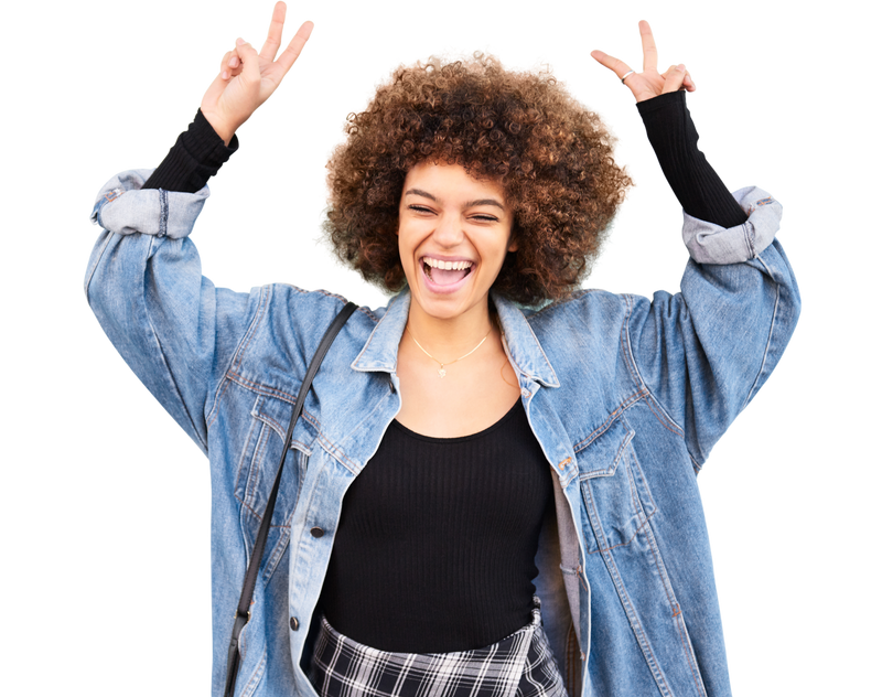 Smiling woman with hands up, wearing an oversized denim shirt